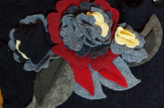Talented designers make scarves with flower appliques from vintage sweaters