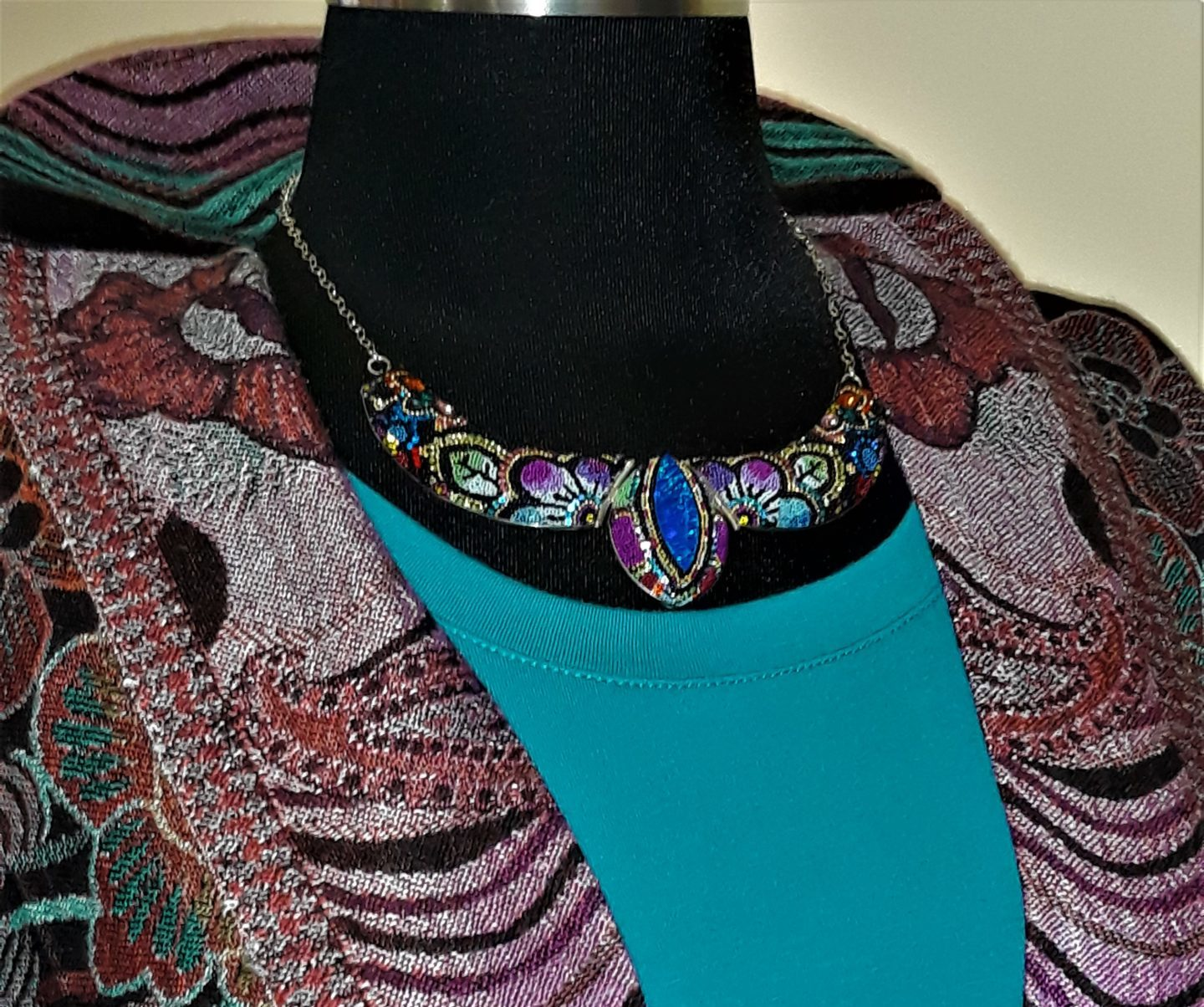 mosiaco-necklace-on-turquois-top-and-jacket-e1576534967602